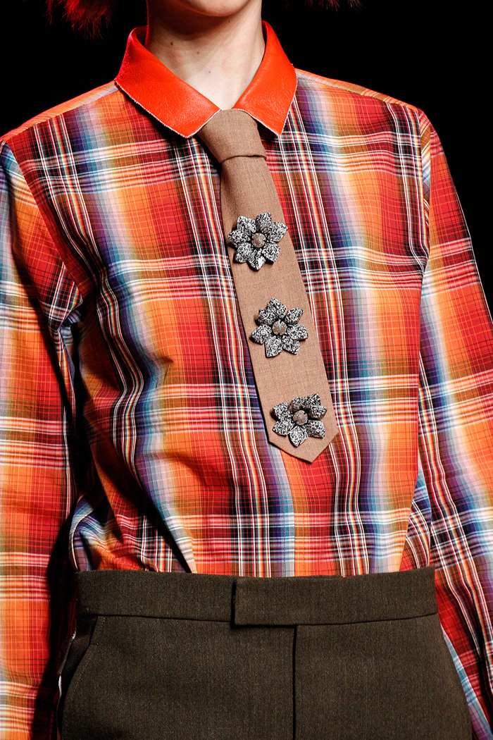 Creatures of the WindI love to see ties back on the catwalks and I love this idea to cover it with pins. I'm sure that three different ones work really well, too.